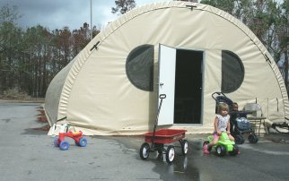 A Quonset hut built at the Buccaneer State park. The daycare center can take up to 15 children a day and is used by families displaced by Hurricane Katrina. Photo credit: Save the Children