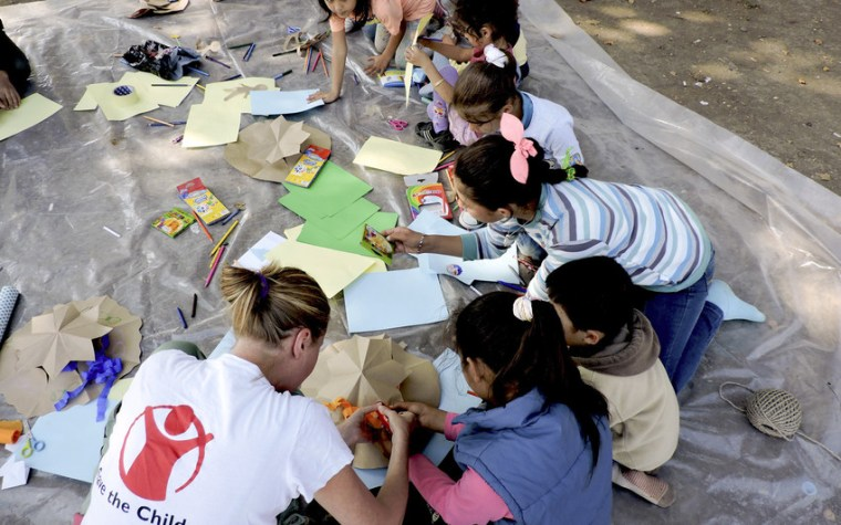 Children play and draw at an art workshop held by Save the Children's mobile Child Friendly Space team in Serbian capital, Belgrade. Our Child Friendly Spaces provide a few hours or normalcy for children, as well as psycho-social support, food and hygiene items, while they wait to continue the journey towards Western Europe. In addition to providing a safe area for children, we provide a space for mothers with babies and toddlers, to enable peaceful breastfeeding, changing diapers, provide support and counselling as well as distribution of baby packs including baby food for toddlers and hygiene items (diapers, baby wipes, baby powder, baby soap). The Child Friendly Spaces also have a role in identifying children travelling alone without a parent or relative and providing them with the support they need and informing them about their rights and the services they are entitled to. Photo Credit: Stuart Sia/Save the Children