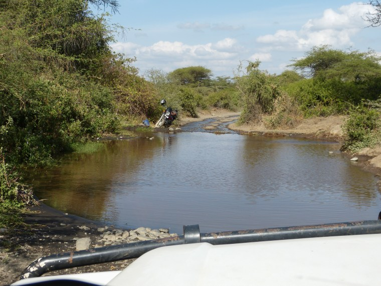 Right before we reach the bushland, we have some water to pass through. tHank goodness we are in a Land Cruiser or we would never be able to pass through here.