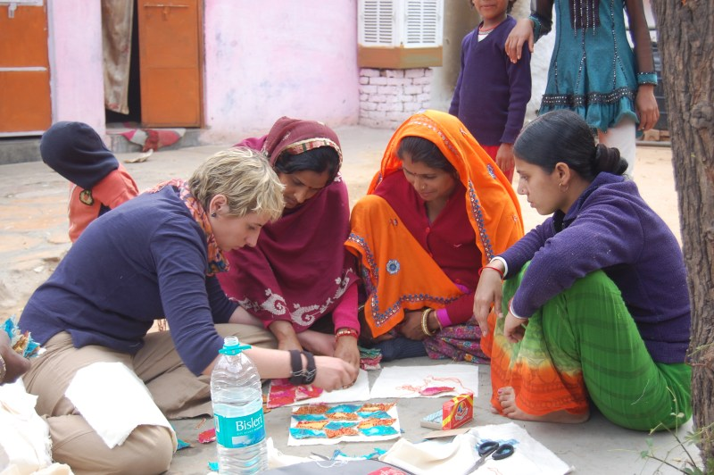 Colleen meeting with the women of Anchal after battling cancer.