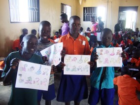 Children from the Carepoint show off their coloring after Clare conducts a handwashing 101 workshop
