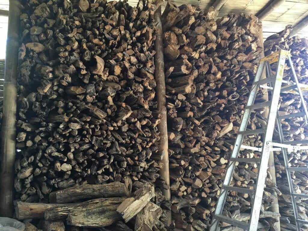 storage area full of stacks of palo santo wood branches