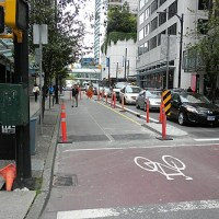 Already There are Cyclists on Dunsmuir St. Separated Bike Lanes