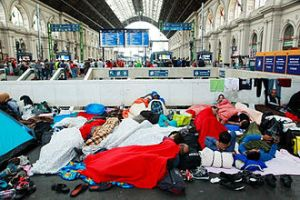 A railway station in Hungary is swamped by 'refugees' on their way to Norhern Europe