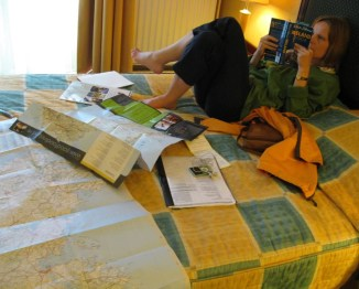 planning trip with tour books and maps