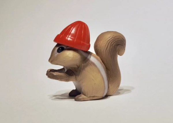 plastic squirrel wearing a toque