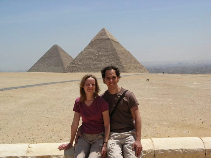 Posing in front of the pyramids