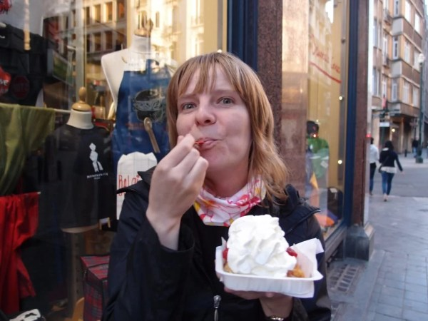 Eating a waffle from Brussels, Belgium