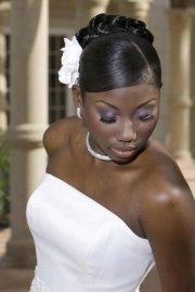 slick bun with flower wedding