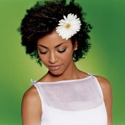 black-curly-wedding-hairstyle-with-flower