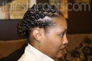 flat twist hairstyle with bun