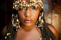 Braids with beads, cowry shells, and more