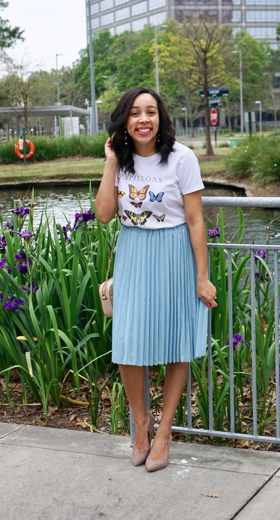 high waisted blue pleated skirt with butterfly tee and sneakers
