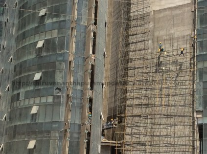 Workers on scaffolding, to give an idea of scale