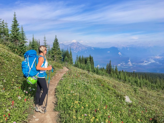 Girl hiking in the Canadian Rocky Mountains following the Skyline Trail.