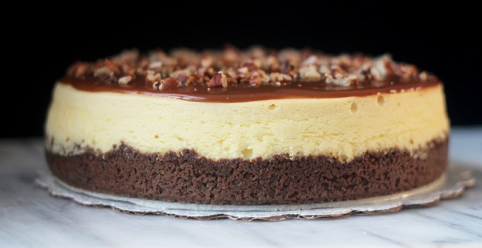 Creamy bourbon toffee cheesecake with crunchy pecans and ginger snap crust