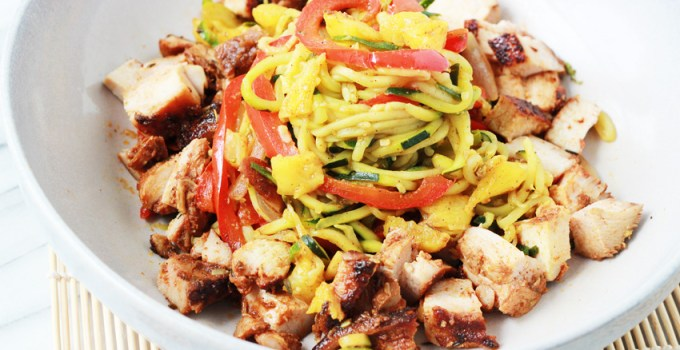 whole30/paleo jerk chicken with stir-fried curry zucchini noodles and pineapples.