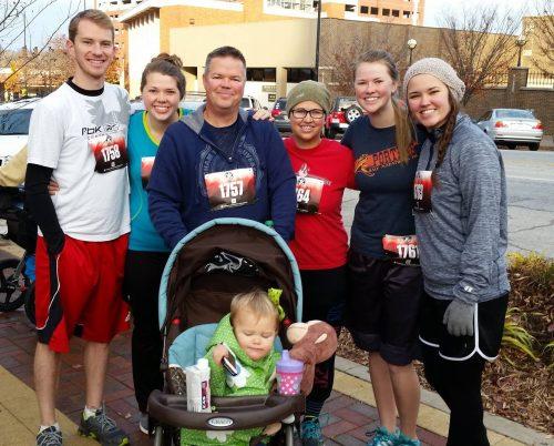 Family having fun at a local 5K race
