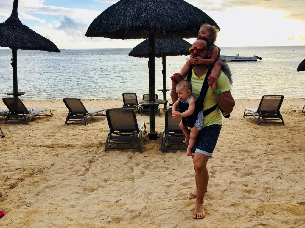 baby sling in use on a Mauritius beach