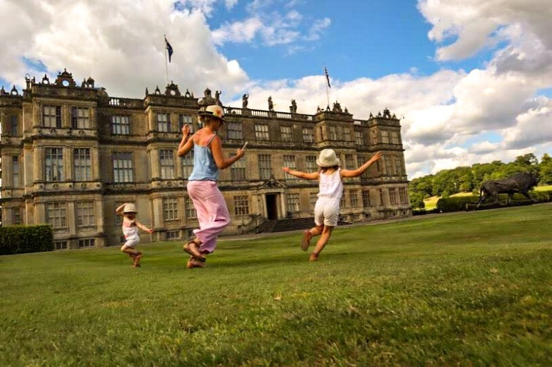 larking around with kids in front of Longleat mansion