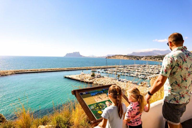 Kids looking over Moraira marina, Spain