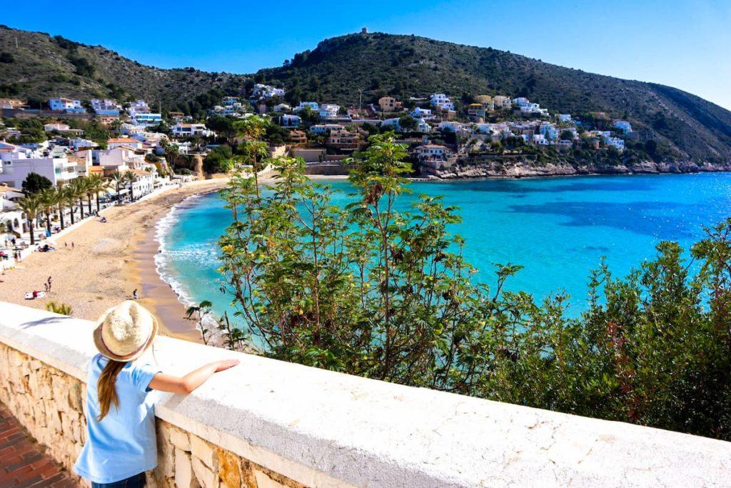 Kid looking over El Portet beach