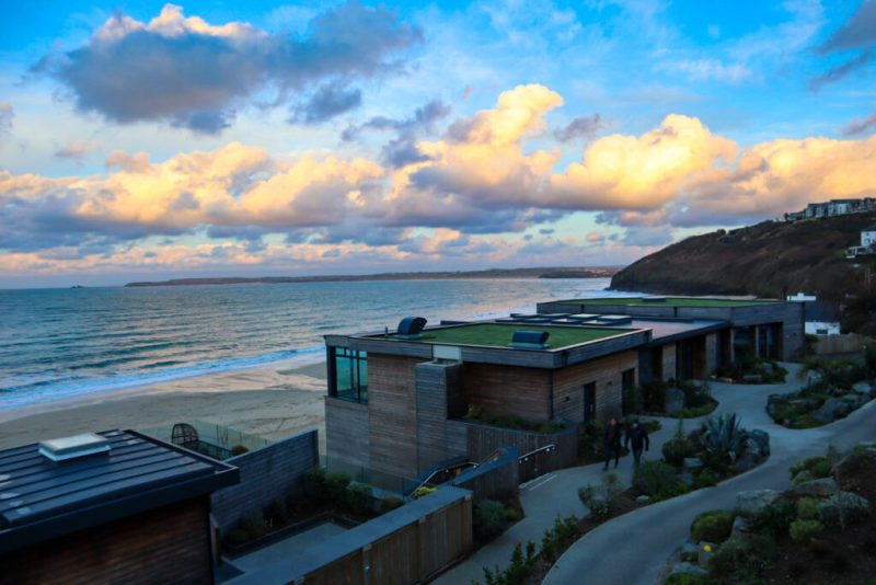 Beach huts overlooking the sea at Carbis Bay Hotel, Cornwall