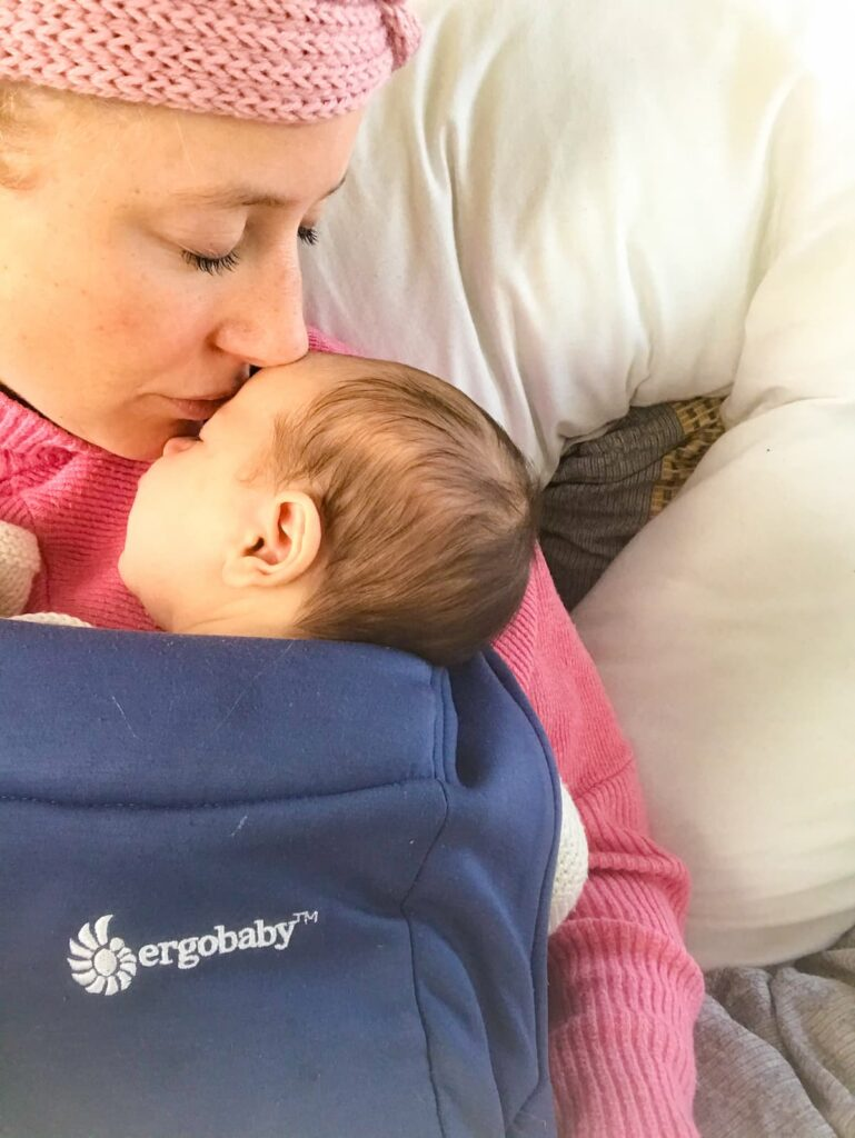 Ergobaby embrace baby carrier head kiss
