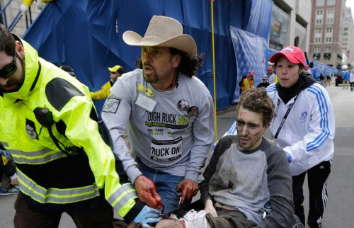 The image of Jeff Bauman, 27, has become iconic of the Boston Marathon attack. In it, Bauman is shown in clear distress, being sped away in a wheelchair while a man in a cowboy hat runs beside him, stemming the blood flow from his femoral arteries. Graphic versions of this photo (which I have edited to protect sensitive readers) are available on Google, and show how heroic both of these men are. Jeff survived and identified one of the bombers