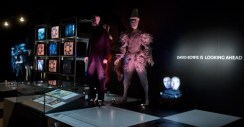 Several costumes with the monitor bank to the left. You saw different videos depending on which square you were standing on.
