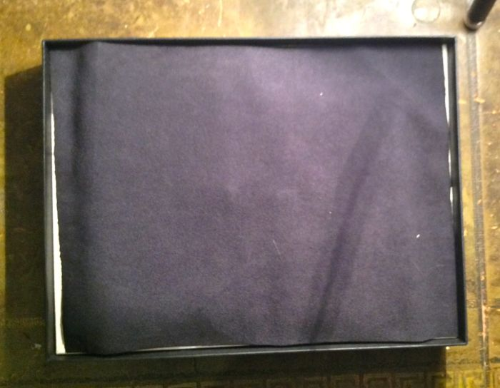 Felt covering the binder and wallet
