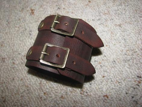 Completely handmade  hand dyed a rich dark mocha brown, hand aged leather, complimented with antique brass finish hardware.
