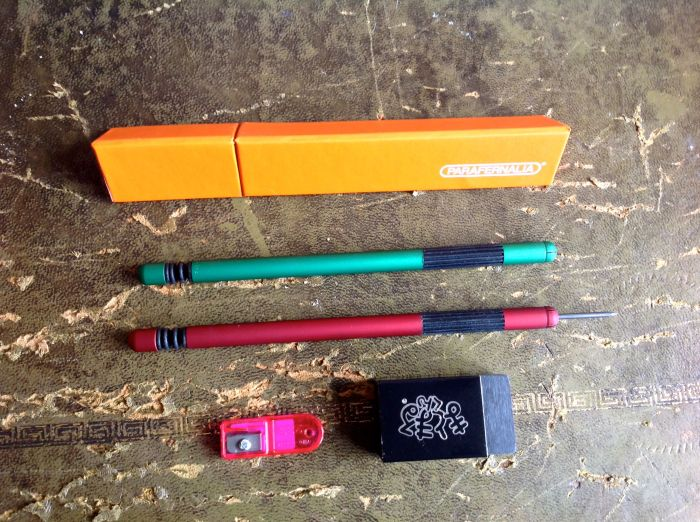 Pencil case, two pencils, an eraser and a lead pointer to sharpen the leads.