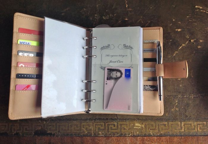 This clear flyleaf comes from a Filofax Doodle. It has an extra pen loop and a pocket, where I keep my driver's licence. Behind that is a frontispiece by Maryanne Moll of Paper Love Forever