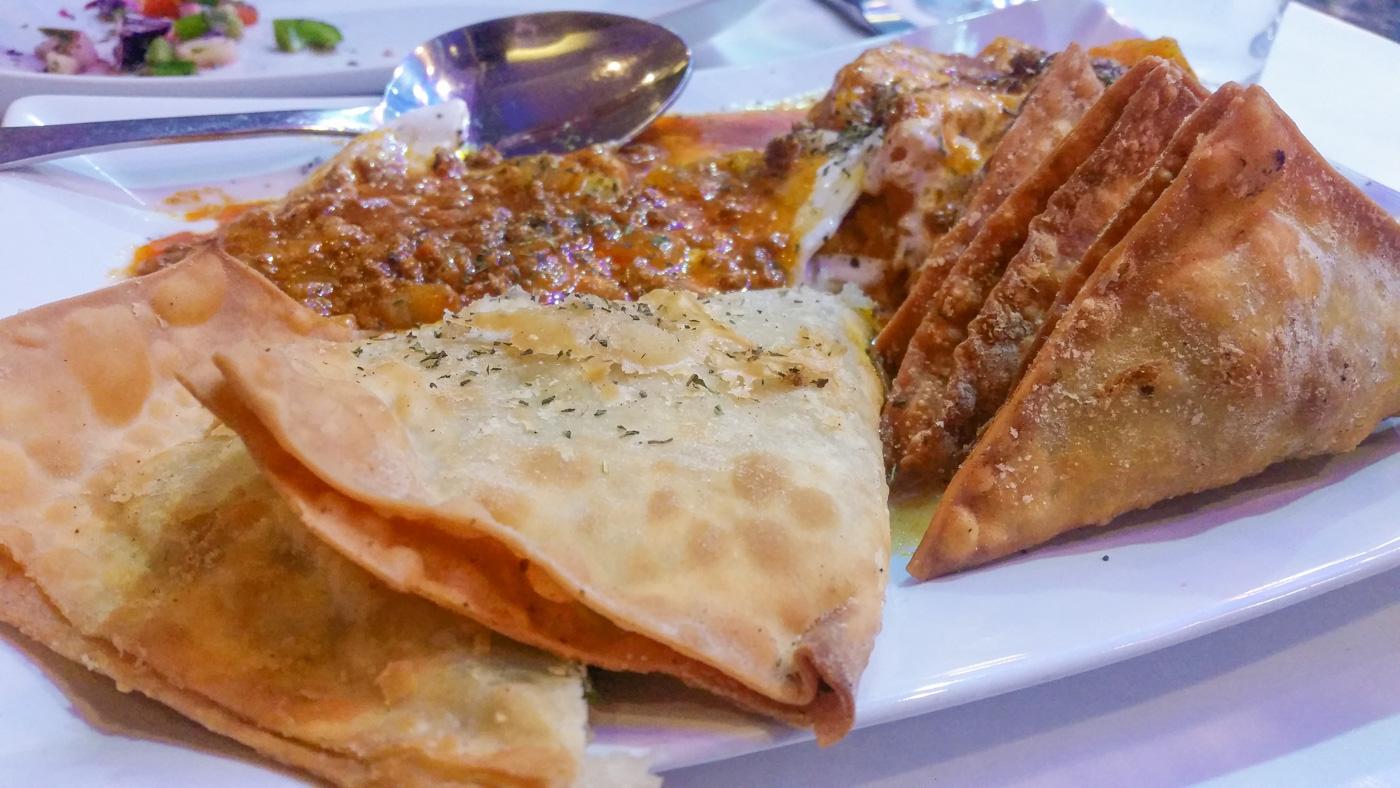 Bulanee (fried leek/potato turnovers), Aushak (leek dumplings topped with yogurt and meat sauce), Sambosa Goshti (lightly fried pastries filled with ground beef, chickpeas, and green peas), Kadu Buranee (pumpkin with garlic yogurt and meat sauce)