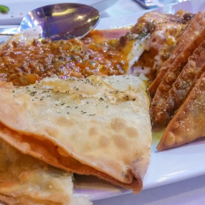 Bulanee (fried leek/potato turnovers), Aushak (leek dumplings topped with yogurt and meat sauce), Sambosa Goshti (lightly fried pastries filled with ground beef, chickpeas, and green peas), Kadu Buranee (pumpkin with garlic yogurt and meat sauce)