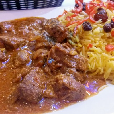 Seasoned lamb or chicken, served with saffron rice and covered with sauteed sweet carrots and raisins