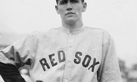 In Boston, Smoky Joe Wood fires a two-hitter at New York, winning, 6 – 0. The Boston ace strikes out 10 in winning his 33rd game.