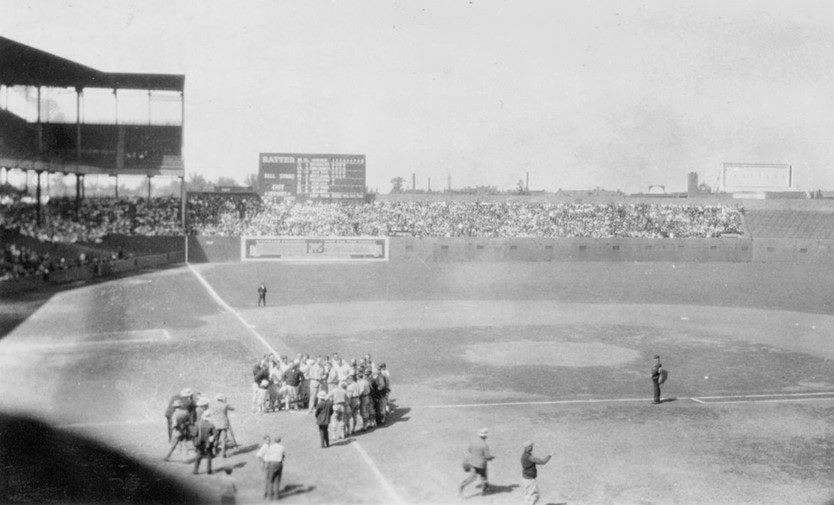 "At Sportsman's Park, the St. Louis Cardinals wear their new uniforms (two red birds on a bat with the words ""Cardinals"" across the front) for the first time in an exhibition contest with the St. Louis Browns. Browns pitcher Urban Shocker tops the Cardinals' Willie Sherdel, 3 – 2, the same result as their matchup a week ago."