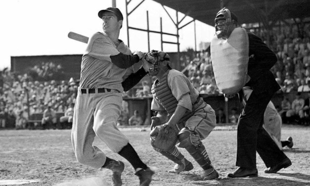 New York Yankees outfielder Joe DiMaggio, a holdout and late arrival in spring training, plays his first exhibition game.