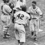 Jackie Robinson congratulates Stan Musial after his homerun in the 1949 All Star Game at Ebbets Field.