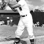 Cuban Carlos Paula integrates the Senators when he collects two hits, playing left field in the team's 8-1 victory over Philadelphia at Griffith Stadium. Next year, the Havana-born outfielder, in his only full season in the majors, will be given consideration for the Rookie of the Year honors as he leads all freshmen by hitting .299.