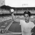 On June 17, 1956, in the ninth inning of the first game of a double-header, 11-year-old Fred Gordon of Brooklyn recovered Joe Adcock's mammoth shot over the left field roof at Ebbets Field off Ed Roebuck of the Dodgers. It was Joe's second homer of the game and the first time a ball landed over the roof. The youngster returned the ball to Joe and received two new balls and the Milwaukee cap he's wearing. The Braves swept the double-header 5-4 and 3-1.