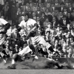 Duke Snider barrels into Billy Martin during the 1956 World Series at Ebbets Field.