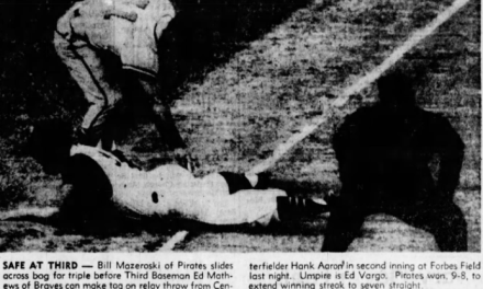 Hank Aaron and Roberto Clemente trade grand slams in a wild battle between the Braves and Pirates