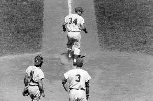 On June 23, 1963, New York Mets' outfielder Jimmy Piersall celebrates his 100th career home run by running in the correct order, but bases backward. Piersall's stunt angers Philadelphia Phillies pitcher Dallas Green and Commissioner Ford Frick. The Mets will hand Jimmy his walking papers two days later by Casey Stengel.