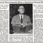 At a press conference, Commissioner Bowie Kuhn announces the publication of The Baseball Encyclopedia and holds up a copy of the 6 1/2 pound book.