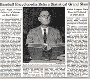 At a press conference, CommissionerBowie Kuhnannounces the publication ofThe Baseball Encyclopediaand holds up a copy of the 6 1/2 pound book.