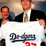 In a deal which upsets many other owners, pitcher Kevin Brown (18-7, 2.38) becomes baseball's first 100+ million dollar man as the right-hander signs a seven-year deal with the Dodgers for an average yearly salary of 15 million dollars.