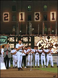 Cal Ripken, Jr. of the Baltimore Orioles breaks one of baseball's most famous records. Ripken plays in his 2,131st consecutive game